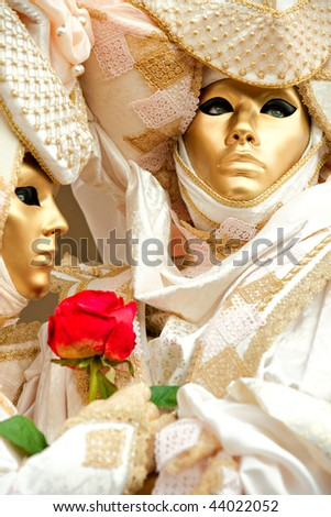 Two gold masks in Venice, Italy. - stock photo