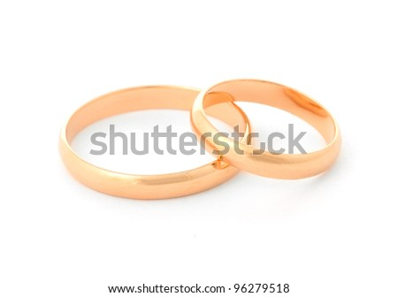 Two gold rings isolated on white background - stock photo