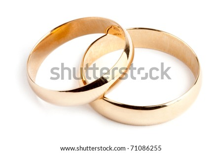 Two gold rings on white background - stock photo