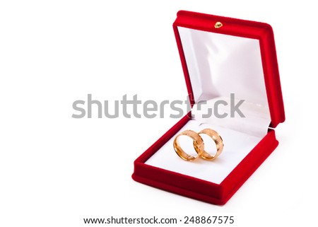 Two gold rings open gift box on a white background - stock photo