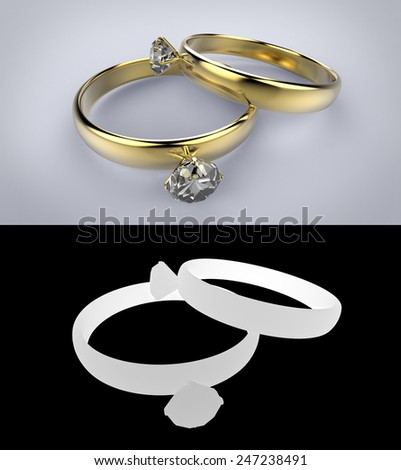 Two gold rings with gem - stock photo