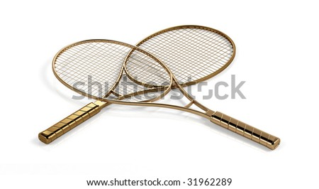 Two gold tennis rackets. - stock photo