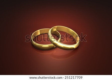 Two gold wedding rings. Rings isolated light on a dark background.  - stock photo