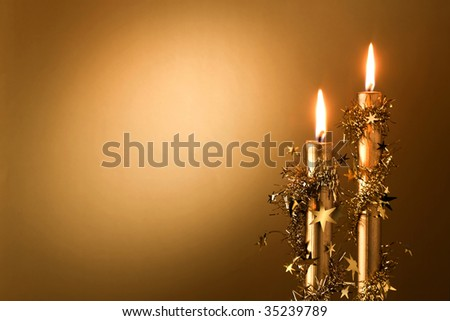 two golden candles with stars - stock photo