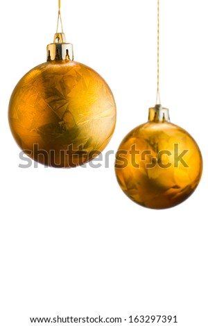 Two golden Christmas balls isolated on white background with copy-spase - stock photo