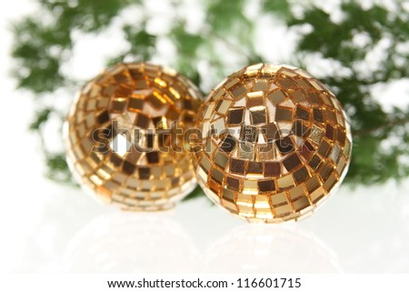 Two golden christmas balls on the firtree - stock photo