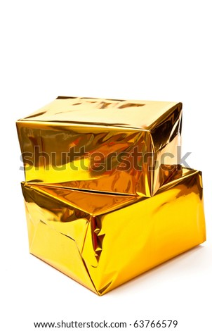 Two golden gifts boxes isolated on white