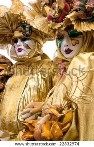 Two golden masks in Venice, Italy. - stock photo