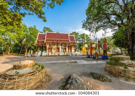 Two golden pagodas in Phra That Doi Tung temple, Chiang Rai province, Thailand. Buddhist monastery and temple of public