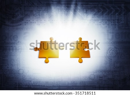 Two golden pieces of the puzzle illuminated - stock photo