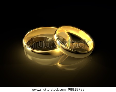 Two golden wedding rings isolated on black background. - stock photo
