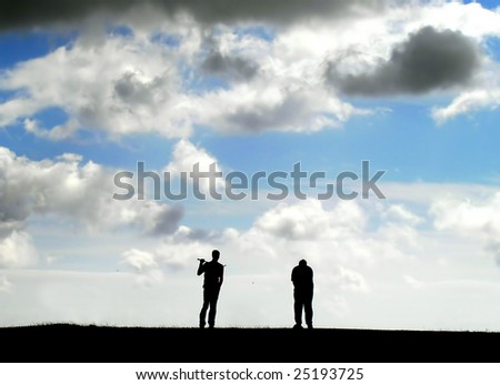 Two Golf players on a hill