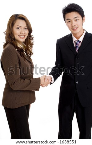 Two good-looking business executives shaking hands