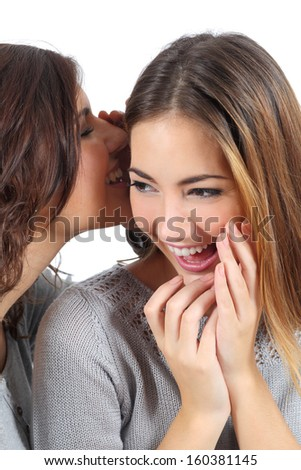 Two gossip teenager girls telling a secret isolated on a white background              - stock photo