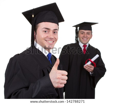 Two graduates with a selective focus used on the first one which is showing a thumbs up sign and the graduate in the background is holding a scroll, isolated on white