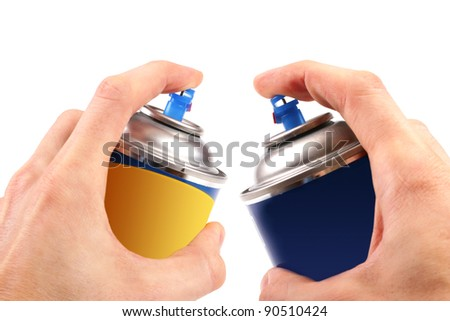 two graffiti color spray cans in hands - stock photo