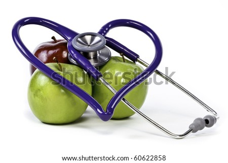 Two granny smith apples and red delicious with heart shaped stethoscope - stock photo
