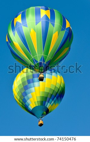 Two Green and Blue Hot Air Balloons - stock photo