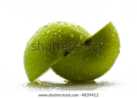 Two green apple halves over white background
