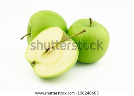 Two green apples and one half on white background - stock photo