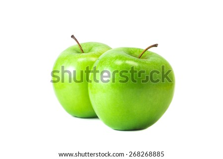 two green apples are next to each other - stock photo