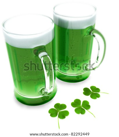 Two green beer's with clovers for St Patrick's day isolated on a white background - stock photo