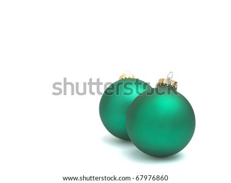 Two green Christmas tree ornaments on white background. - stock photo