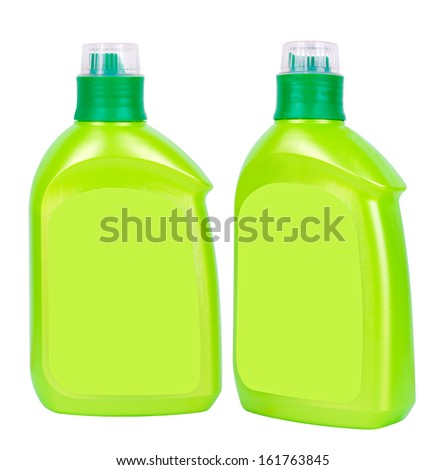 Two green closed plastic soap bottles isolated on white - stock photo