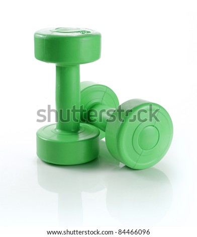 two green dumbell over white background - stock photo