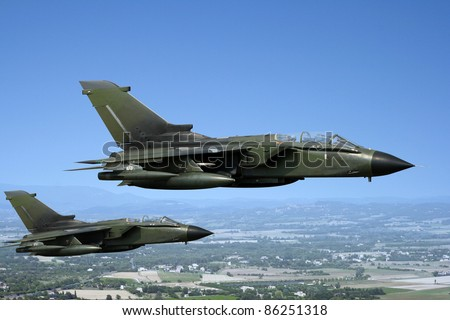 Two green fighter jets - stock photo
