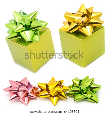 two green gift box with color ribbons