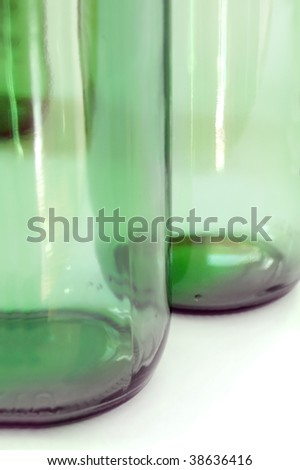 two green glass bottles on white background - stock photo