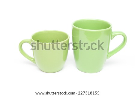 Two green mugs empty blank, isolated on white background - stock photo