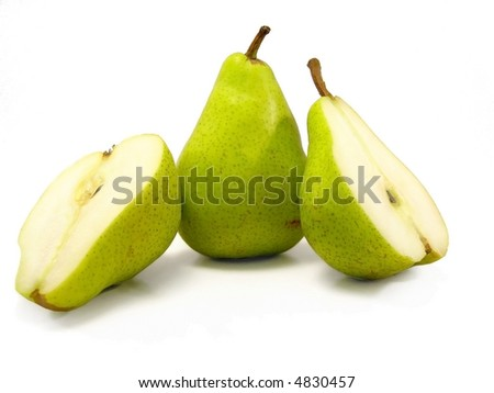 two green pears, one sliced in half, the other is one piece, on a white background.