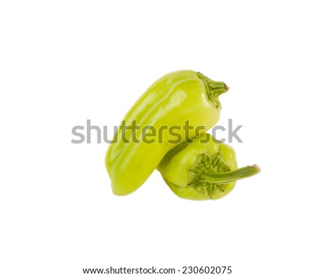 Two  Green peppers  isolated over white background