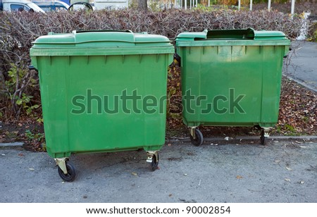 Two green recycling containers - stock photo