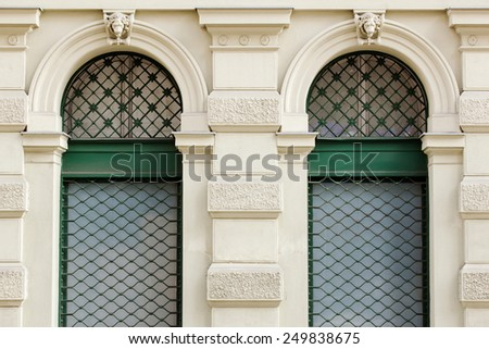 two green windows on wall - stock photo