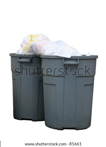 Two grey rubber (dirty) trash cans filled to the top. Rain drops covering the bags. - stock photo
