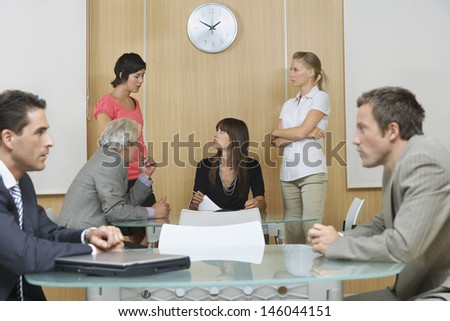 Two groups of businesspeople having meetings in conference room - stock photo