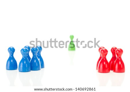 Two groups of meeples against the green meeple - stock photo