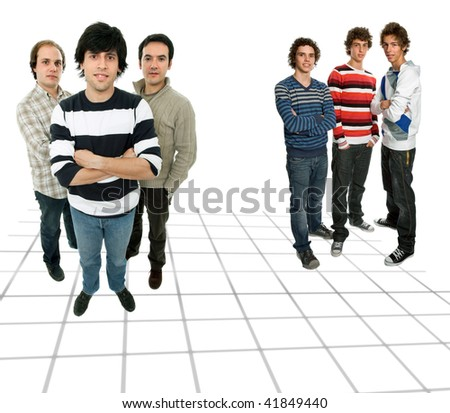 two groups of young men, studio picture - stock photo