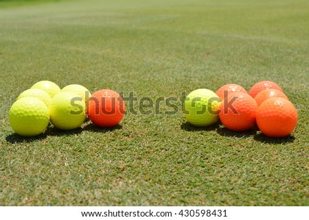 Two Groups, Orange, Yellow Golf Balls, Hole, Field, Unique, Different, Competition, Bright Leadership