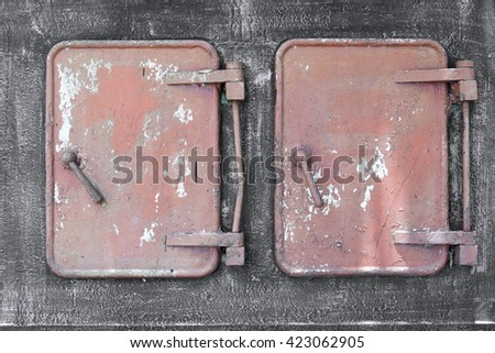 Two grunge metallic rusty doors with leverages - stock photo