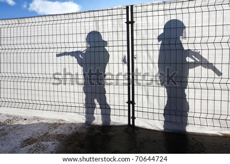 Two Guardians are holding there Weapons in the Sun - stock photo