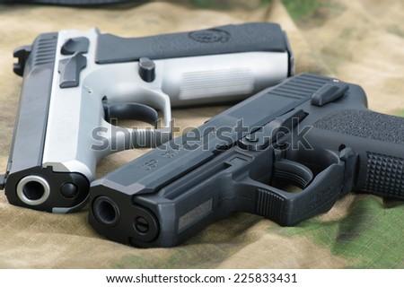Two guns - stock photo