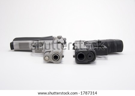 Two guns on white background 9 mm gun and glock 45 - stock photo