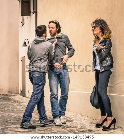 Two Guys fighting over a Girl - stock photo