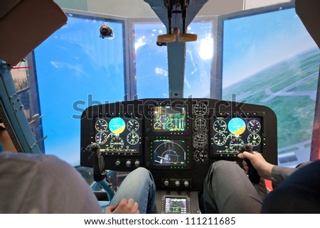 Two guys  flying on helicopter simulator - stock photo
