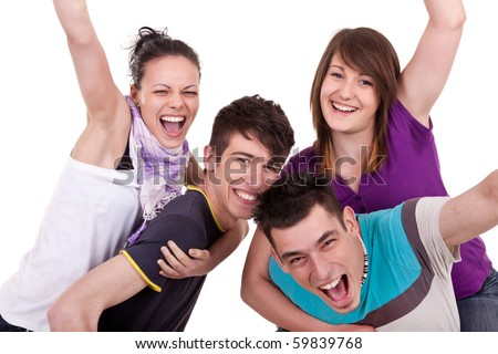 two guys giving piggyback rides to their girlfriends - stock photo
