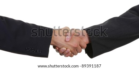 two guys shaking hands wearing suits - stock photo